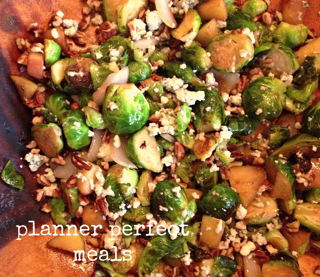 brussels sprouts and apples with pecans and gorgonzola in a maple balsamic glaze